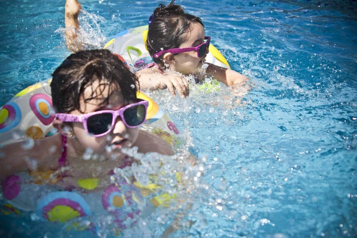 Children Swimming in Clean Pool by GPS Pools
